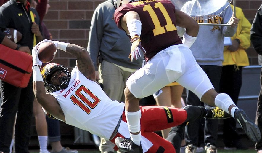 Maryland wide receiver D.J. Turner (10) makes a diving catch in front of Minnesota safety Antoine Winfield Jr. (11) on fourth down in the first quarter of an NCAA college football game on Saturday, Sept. 30, 2017, in Minneapolis.(AP Photo/Andy Clayton-King)