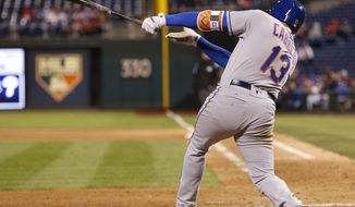 New York Mets' Asdrubal Cabrera hits a three-run home run during the 11th inning of a baseball game against the Philadelphia Phillies, Saturday, Sept. 30, 2017, in Philadelphia. The Mets won 7-4 in 11 innings. (AP Photo/Chris Szagola)