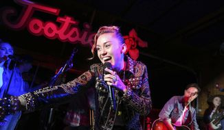 "Miley Cyrus performs at a private concert event at Tootsie's to celebrate the release of her album ""Younger Now"" on Friday, Sept. 29, 2017, in Nashville, Tenn. (Photo by Laura Roberts/Invision/AP)"