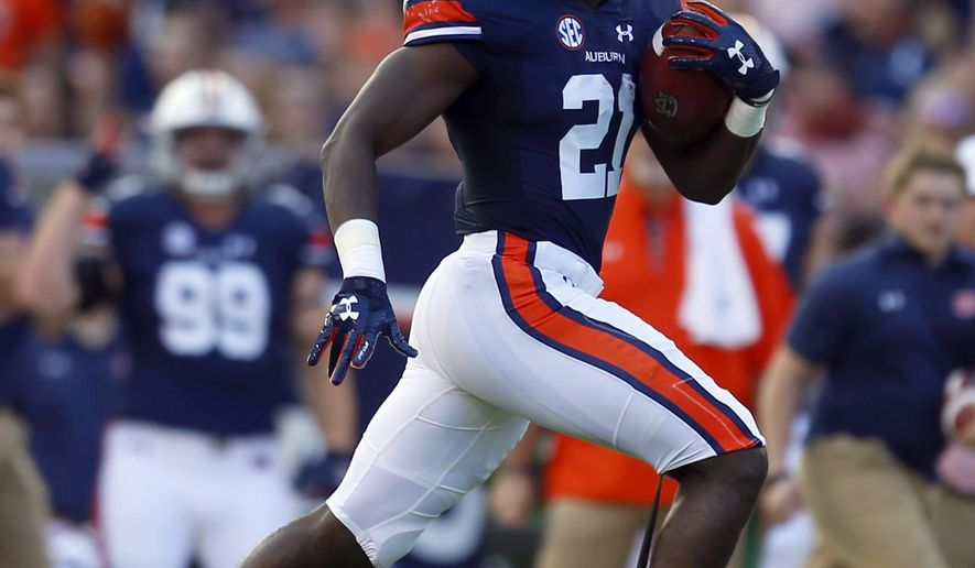 Auburn running back Kerryon Johnson (21) breaks free for a long run during the first half of an NCAA college football game against Mississippi State, Saturday, Sept. 30, 2017, in Auburn, Ala. (AP Photo/Butch Dill)
