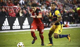 Toronto FC's Marky Delgado, left, chases the ball ahead of New York Red Bulls' Tyler Adams during the second half of an MLS soccer game, Saturday, Sept. 30, 2017, in Toronto. (Jon Blacker/The Canadian Press via AP)