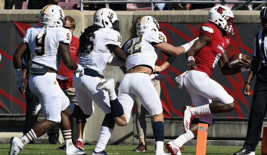 Murray State's Dylan Boone (22), Jason Johnson (16), and Lamont Crittendon (9) pursue Louisville's Lamar Jackson (8) as he crosses the corner of the end zone to score during the first half of an NCAA college football game Saturday, Sept. 30, 2017, in Louisville, Ky. (AP Photo/Timothy D. Easley)