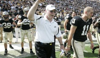 FILE - In this Sept. 29, 2007 file photo, Purdue coach Joe Tiller, celebrates a 33-19 football victory against Notre Dame in West Lafayette, Ind. Tiller, the winningest football coach in Purdue history, died Saturday, Sept. 30, 2017, in Buffalo, Wyo., the school said. He was 74.(AP Photo/Michael Conroy, file)