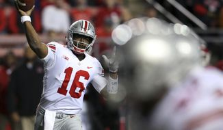 Ohio State quarterback J.T. Barrett (16) throws a pass during the first half of an NCAA college football game against Rutgers, Saturday, Sept. 30, 2017, in Piscataway, N.J. (AP Photo/Mel Evans)