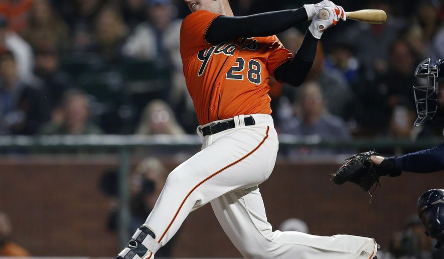 San Francisco Giants' Buster Posey watches his double against the San Diego Padres during the first inning of a baseball game Friday, Sept. 29, 2017, in San Francisco. (AP Photo/Tony Avelar)
