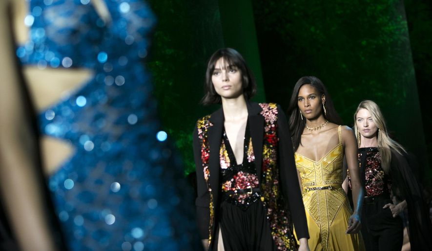 Models, including Cindy Bruna, second from right, and Martha Hunt, right, wear creations for Elie Saab's Spring-Summer 2018 ready-to-wear fashion collection presented Saturday, Sept. 30, 2017 in Paris. (AP Photo/Kamil Zihnioglu)