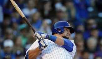 Chicago Cubs' Kyle Schwarber breaks his bat on a two-run single against the Cincinnati Reds during the third inning of a baseball game Saturday, Sept. 30, 2017, in Chicago. (AP Photo/Jim Young)