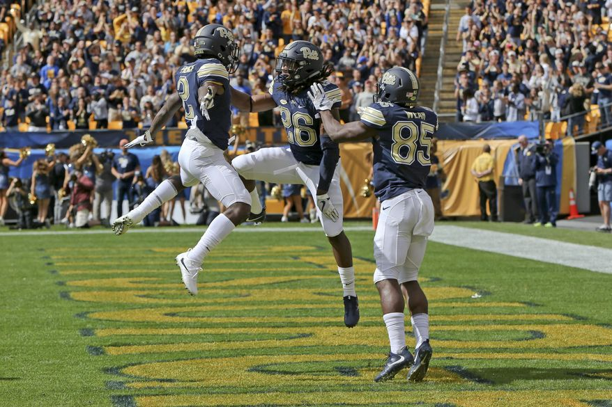 Pittsburgh running back Chawntez Moss (26) celebrates with teammates Jester Weah (85) and Maurice Ffrench (2) after scoring a touchdown against Rice in the first quarter of an NCAA college football game, Saturday, Sept. 30, 2017, in Pittsburgh. (AP Photo/Keith Srakocic)