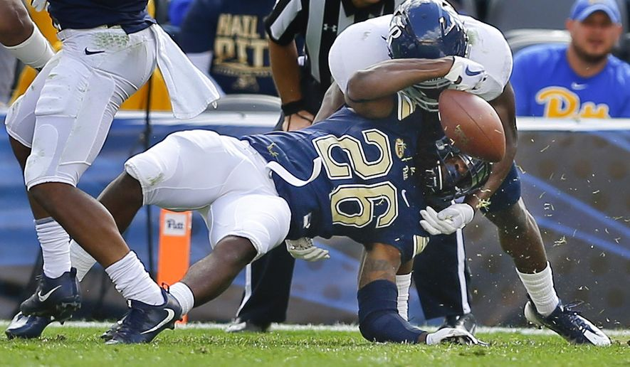 Rice safety J.T. Ibe, top right, knocks the ball loose from Pittsburgh running back Chawntez Moss (26) as he tries to score on a run in the second quarter of an NCAA college football game, Saturday, Sept. 30, 2017, in Pittsburgh. Ibe recovered the fumble for Rice.  (AP Photo/Keith Srakocic)