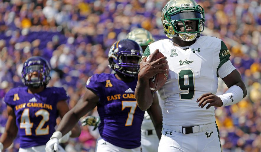 South Florida's Quinton Flowers (9) scores a touchdown during the first half of an NCAA college football game against East Carolina in Greenville, N.C., Saturday, Sept. 30, 2017. (AP Photo/Karl B DeBlaker)
