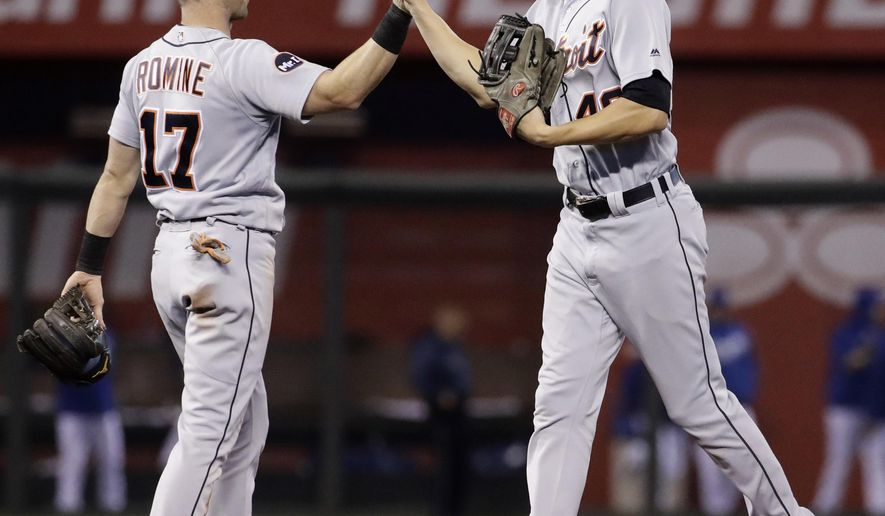 Detroit Tigers' Andrew Romine (17) and JaCoby Jones celebrate after a baseball game against the Kansas City Royals, Thursday, Sept. 28, 2017, in Kansas City, Mo. (AP Photo/Charlie Riedel)