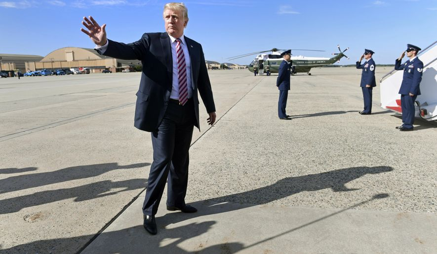 President Donald Trump waves as he prepares to board Air Force One at Andrews Air Force Base in Md., Friday, Sept. 29, 2017, after talking with reporters. Trump is heading to New Jersey for the weekend. (AP Photo/Susan Walsh)