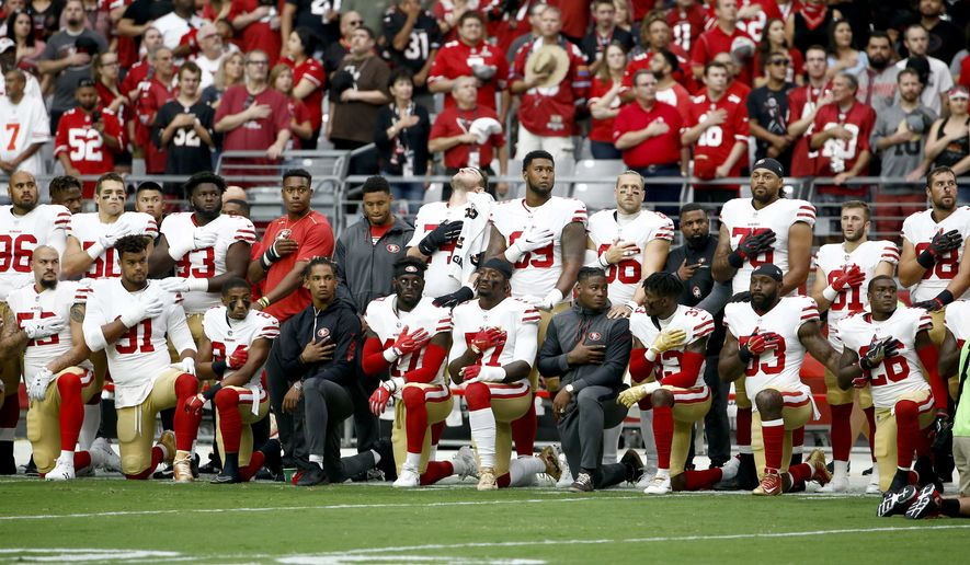 Members of the San Francisco 49ers kneel as others stands during the national anthem prior to an NFL football game against the Arizona Cardinals, Sunday, Oct. 1, 2017, in Glendale, Ariz. (AP Photo/Ross D. Franklin)