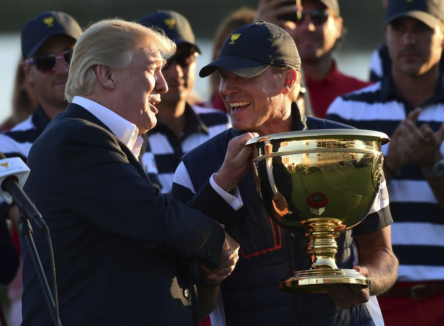President Donald Trump participates in presenting the Presidents Cup to the United States team at the Jersey City Golf Club in Jersey City, N.J., Sunday, Oct. 1, 2017, after the United States team defeated the International team in the Presidents Cup for the 7th straight time. (AP Photo/Susan Walsh)