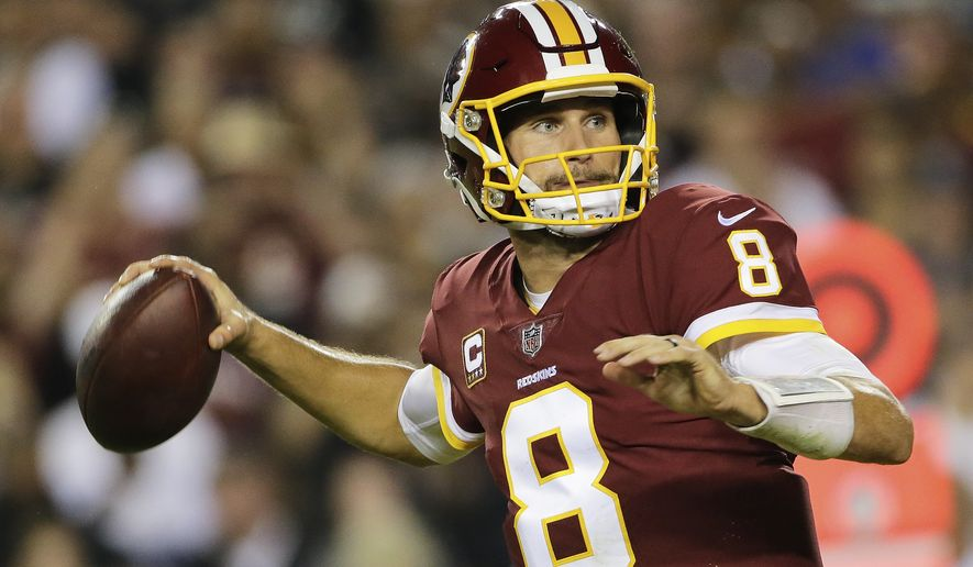 FILE - In this Sept. 24, 2017, fie photo, Washington Redskins quarterback Kirk Cousins (8) passes the ball during the first half of an NFL football game against the Oakland Raiders in Landover, Md. Just about the only things that Kansas City Chiefs quarterback Alex Smith and Cousins have in common heading into their Monday night showdown have been the results. (AP Photo/Mark Tenally, File)