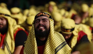 Lebanese Shiite supporters of Hezbollah cry as listen to the story of Imam Hussein, during activities marking the holy day of Ashoura, in southern Beirut, Lebanon, Sunday, Oct. 1, 2017. Ashoura is the annual Shiite Muslim commemoration marking the death of Imam Hussein, the grandson of the Prophet Muhammad, at the Battle of Karbala in present-day Iraq in the 7th century. (AP Photo/Hassan Ammar)