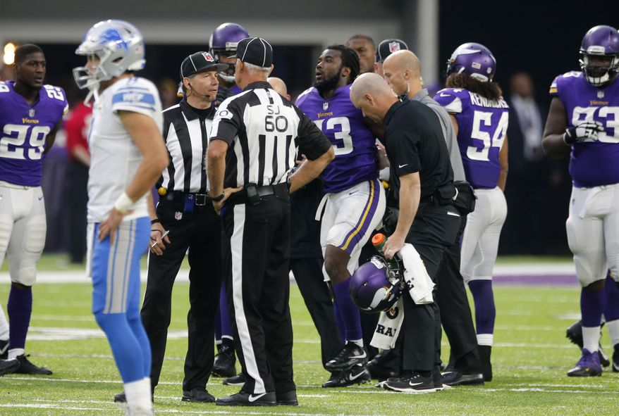 Minnesota Vikings running back Dalvin Cook (33) is helped off the field after getting injured during the second half of an NFL football game against the Detroit Lions, Sunday, Oct. 1, 2017, in Minneapolis. (AP Photo/Jim Mone)