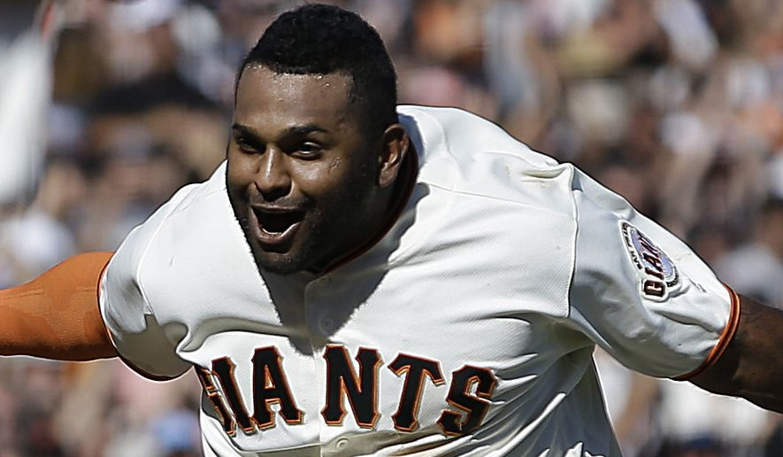 San Francisco Giants' Pablo Sandoval celebrates after hitting a walk off home run against the San Diego Padres in the ninth inning of a baseball game Sunday, Oct. 1, 2017, in San Francisco. (AP Photo/Ben Margot)