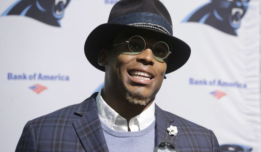 Carolina Panthers quarterback Cam Newton speaks to the media following an NFL football game against the Carolina Panthers, Sunday, Oct. 1, 2017, in Foxborough, Mass. (AP Photo/Steven Senne)