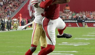 Arizona Cardinals wide receiver Larry Fitzgerald (11) pulls in the game winning touchdown as San Francisco 49ers cornerback Rashard Robinson defends during overtime of an NFL football game, Sunday, Oct. 1, 2017, in Glendale, Ariz. The Cardinals won 18-15. (AP Photo/Rick Scuteri)
