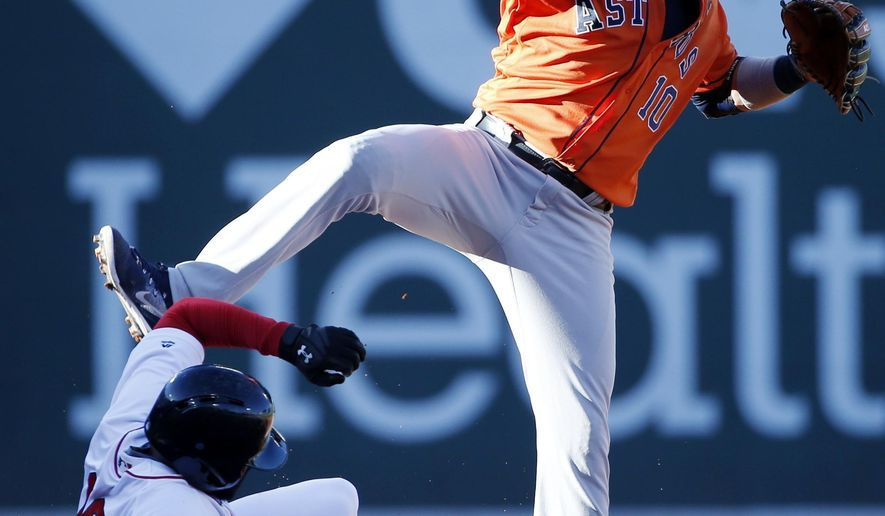 Boston Red Sox's Jackie Bradley Jr. (19) is forced out at second base as Houston Astros' Yuli Gurriel (10) turns the double play on Sam Travis during the fourth inning of a baseball game in Boston, Sunday, Oct. 1, 2017. (AP Photo/Michael Dwyer)