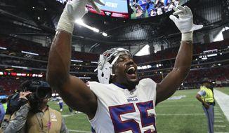 Buffalo Bills defensive end Jerry Hughes celebrates the Bills win over the Atlanta Falcons after an NFL football game, Sunday, Oct. 1, 2017, in Atlanta. The Buffalo Bills won 23-17. (AP Photo/John Bazemore)