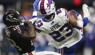 Buffalo Bills strong safety Micah Hyde (23) intercepts a pass intended for Atlanta Falcons wide receiver Taylor Gabriel (18) during the second half of an NFL football game, Sunday, Oct. 1, 2017, in Atlanta. (AP Photo/John Bazemore)