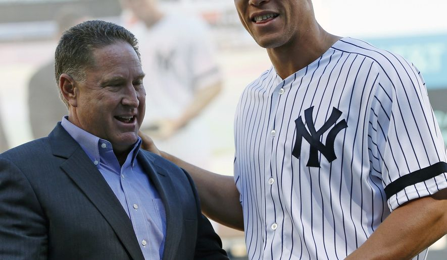 New York Yankees amateur scouting director Damon Oppenheimer, left, presents New York Yankees rookie Aaron Judge with a crystal gavel before a baseball game in New York, Sunday, Oct. 1, 2017. Judge has hit 53 home runs in his rookie season for the Yankees. (AP Photo/Kathy Willens)