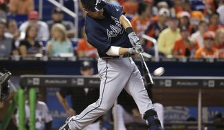 Atlanta Braves' Kurt Suzuki hits a two run home run during the third inning of a baseball game against the Miami Marlins, Sunday, Oct. 1, 2017, in Miami. (AP Photo/Lynne Sladky)