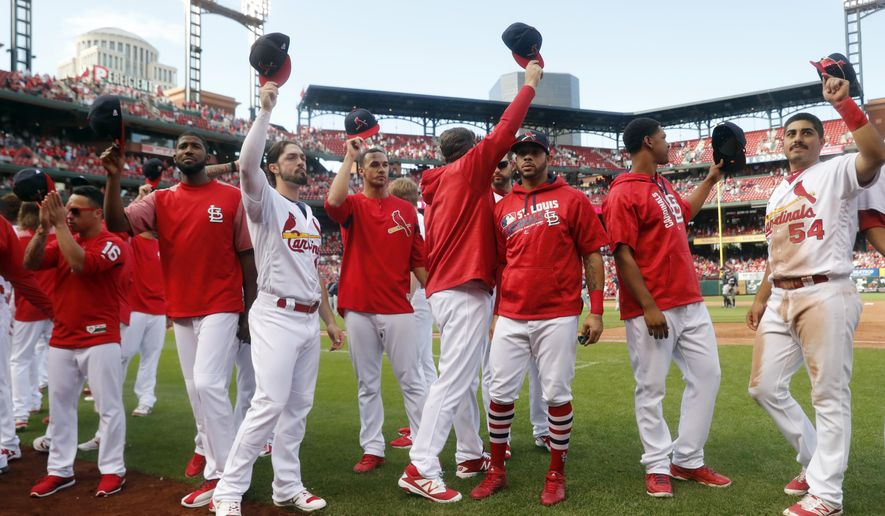 Members of the St. Louis Cardinals wave to fans following a baseball game against the Milwaukee Brewers Sunday, Oct. 1, 2017, in St. Louis. The Brewers won 6-1. (AP Photo/Jeff Roberson)