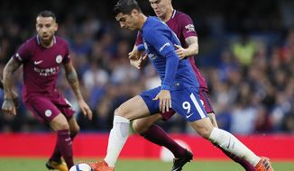 Chelsea's Alvaro Morata, left, is challenged for the ball by Manchester City's John Stones during their English Premier League soccer match between Chelsea and Manchester City at Stamford Bridge stadium in London, Saturday, Sept. 30, 2017. (AP Photo/Kirsty Wigglesworth)