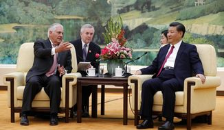 U.S. Secretary of State Rex Tillerson, left, chats with China's President Xi Jinping during a meeting at the Great Hall of the People in Beijing, Saturday, Sept. 30, 2017. (AP Photo/Andy Wong, Pool)