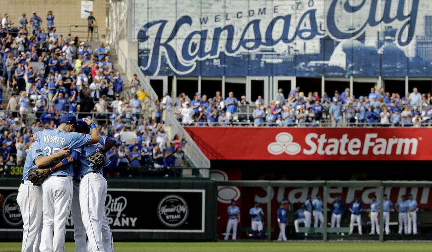 Veteran Kansas City Royals players Eric Hosmer, Lorenzo Cain, Mike Moustakas and Alcides Escobar gather in the infield before coming out of the game during the fifth inning of a baseball game against the Arizona Diamondbacks Sunday, Oct. 1, 2017, in Kansas City, Mo. (AP Photo/Charlie Riedel)