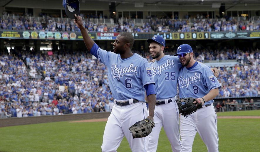 Veteran Kansas City Royals players Lorenzo Cain (6), Eric Hosmer (35) and Mike Moustakas (8) acknowledge the crowd as they come out of a baseball game during the fifth inning against the Arizona Diamondbacks, Sunday, Oct. 1, 2017, in Kansas City, Mo. (AP Photo/Charlie Riedel)