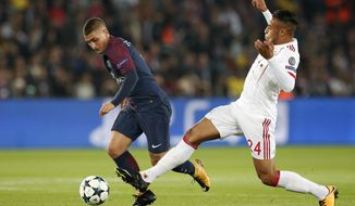 PSG's Marco Verratti, left, and Bayern's Corentin Tolisso vie for the ball during a Champions League Group B soccer match between Paris Saint-Germain and Bayern Munich at the Parc des Princes stadium in Paris, France, Wednesday, Sept. 27, 2017. (AP Photo/Christophe Ena)