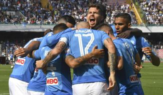 Napoli's Dries Mertens, center, celebrates with teammates after scoring during a Serie A match soccer match between Napoli and Cagliari at the San Paolo stadium in Naples, Italy, Sunday, Oct. 1, 2017. (Ciro Fusco/ANSA via AP)