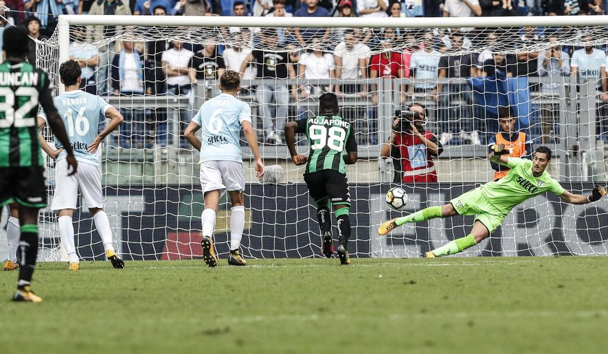 Sassuolo's Domenico Berardi, not pictured, scores past Lazio's goalkeeper Thomas Strakosha, right, during the Italian Serie A soccer match between Lazio and Sassuolo at the Olympic stadium in Rome, Italy, Sunday, Oct. 1, 2017. (Giuseppe Lami/ANSA via AP)