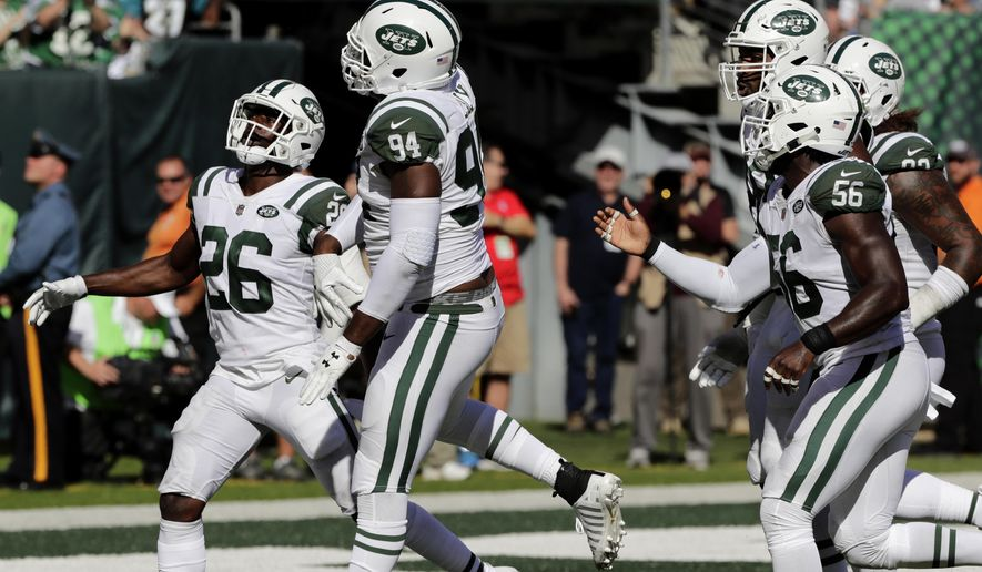 New York Jets' Kony Ealy, second from left, celebrates his interception with Marcus Maye, left, and others during the second half of an NFL football game against the Jacksonville Jaguars, Sunday, Oct. 1, 2017, in East Rutherford, N.J. (AP Photo/Frank Franklin II)