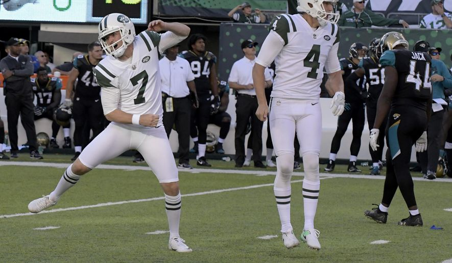 New York Jets kicker Chandler Catanzaro, left, reacts after hitting the game winning field goal during the overtime period of an NFL football game against the Jacksonville Jaguars, Sunday, Oct. 1, 2017, in East Rutherford, N.J. The Jets defeated the Jaguars 23-20. (AP Photo/Bill Kostroun)