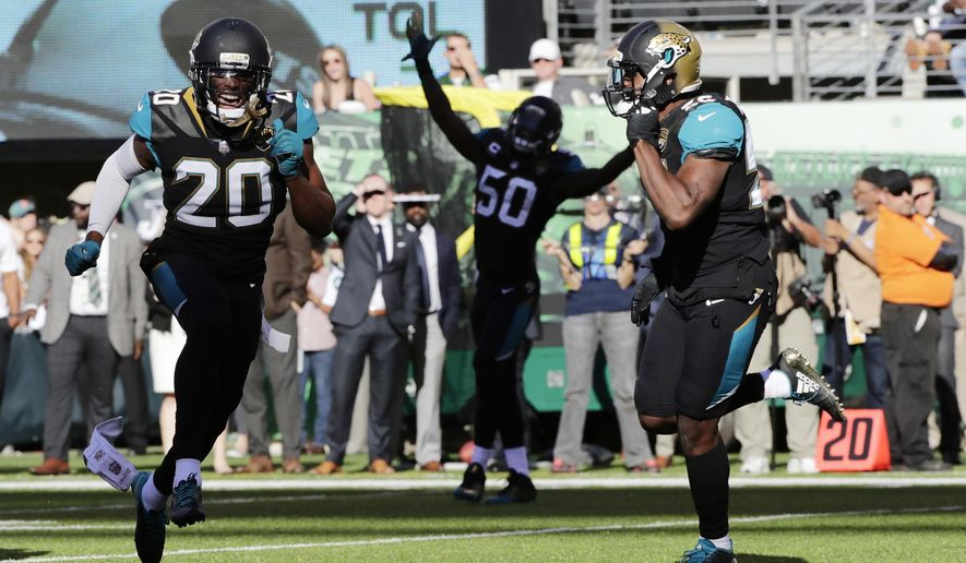 Jacksonville Jaguars' Jalen Ramsey, left, celebrates with teammates during the overtime period of an NFL football game, Sunday, Oct. 1, 2017, in East Rutherford, N.J. (AP Photo/Frank Franklin II)