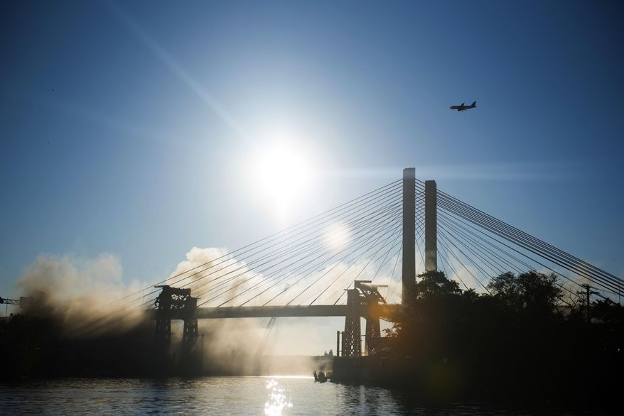 The old Kosciuszko Bridge is imploded on Sunday, Oct. 1, 2017 in New York. Over 900 explosives brought down the 20 remaining steel truss spans. The eastbound span of the new Kosciuszko Bridge opened in April. The second span is scheduled to be finished by 2020. (AP Photo/Michael Noble Jr.)
