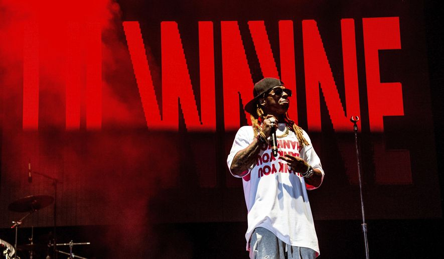FILE - Lil Wayne performs at the Lil' WeezyAna Fest at Champions Square on Friday, Aug. 25, 2017, in New Orleans. Fans of rapper Lil Wayne will be offered refunds after the recording artist on Saturday, Sept. 30, 2017 refused to pass through a security check to enter the Colonial Life Arena in Columbia, and skipped the concert.  (Photo by Amy Harris/Invision/AP, File)