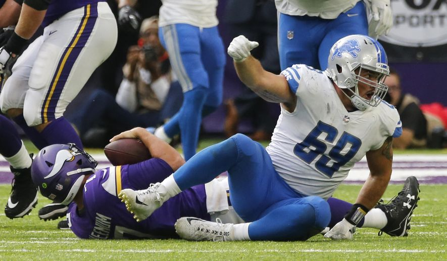Detroit Lions defensive end Anthony Zettel (69) celebrates after sacking Minnesota Vikings quarterback Case Keenum, left, during the second half of an NFL football game, Sunday, Oct. 1, 2017, in Minneapolis. (AP Photo/Jim Mone)