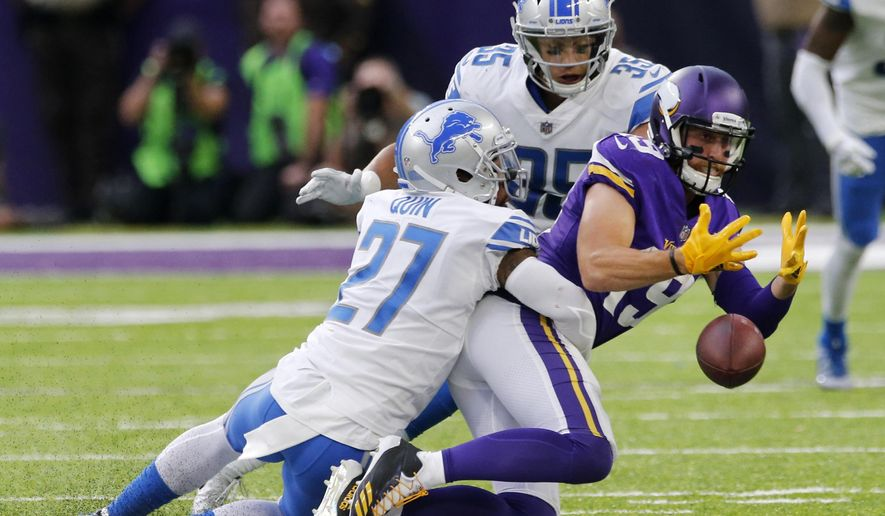 Minnesota Vikings wide receiver Adam Thielen (19) fumbles the ball as he is tackled by Detroit Lions free safety Glover Quin (27) and strong safety Miles Killebrew (35) during the second half of an NFL football game, Sunday, Oct. 1, 2017, in Minneapolis. The Lions won 14-7. (AP Photo/Jim Mone)