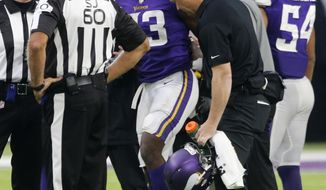 Minnesota Vikings running back Dalvin Cook (33) is helped off the field after being injured during the second half of an NFL football game against the Detroit Lions, Sunday, Oct. 1, 2017, in Minneapolis. (AP Photo/Jim Mone)
