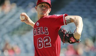 Los Angeles Angels pitcher Parker Bridwell throws to the Seattle Mariners in the first inning of a baseball game in Anaheim, Calif., Sunday, Oct. 1, 2017. (AP Photo/Reed Saxon)