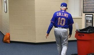 New York Mets manager Terry Collins walks from his office after resigning as manager following a game against the Philadelphia Phillies, Sunday, Oct. 1, 2017, in Philadelphia. New York Mets manager Terry Collins resigned Sunday and will take a position in the team's front office. Collins announced the move after the Mets lost to Philadelphia 11-0 to finish the season.  (AP Photo/Derik Hamilton)