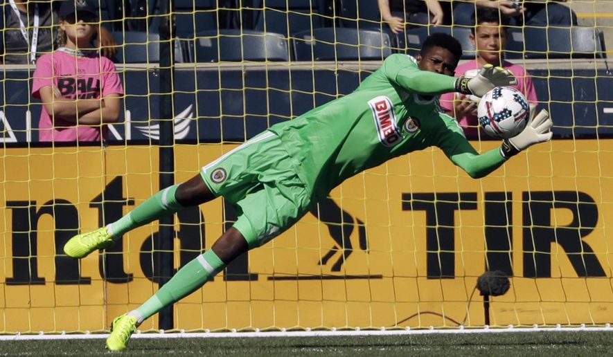 Philadelphia Union's Andre Blake blocks a shot during the second half of an MLS soccer match against the Seattle Sounders, Sunday, Oct. 1, 2017, in Chester, Pa. (AP Photo/Matt Slocum)