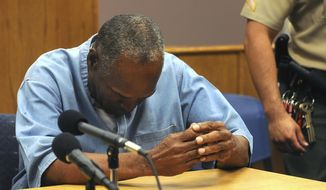 In this July 20, 2017, file photo, former NFL football star O.J. Simpson reacts after learning he was granted parole at Lovelock Correctional Center in Lovelock, Nev. (Jason Bean/The Reno Gazette-Journal via AP, Pool, File)