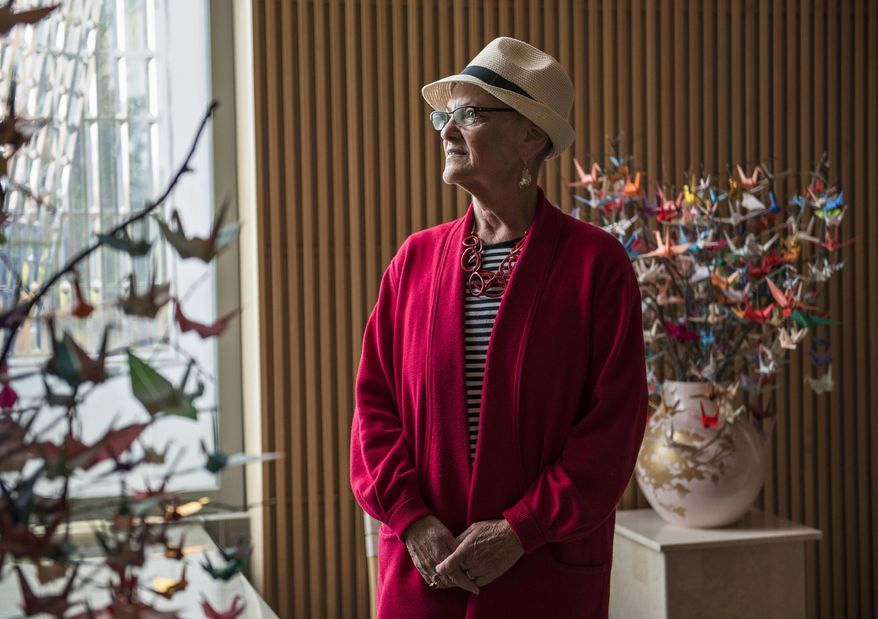 In this Sept. 18, 2017 photo, Teri Giangreco, of Vancouver, who was diagnosed with ovarian cancer in January and is still undergoing treatment stands for a portrait at Salmon Creek Medical Center in Vancouver, Wash.  Giangreco didn't know the warning signs of ovarian cancer until after her diagnosis, so she's teamed up with Legacy Salmon Creek Medical Center and the Ovarian Cancer Alliance of Oregon and Southwest Washington to spread the word about signs and symptoms. (Alisha Jucevic/The Columbian via AP)